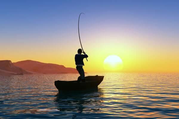 Man inshore fishing on small boat