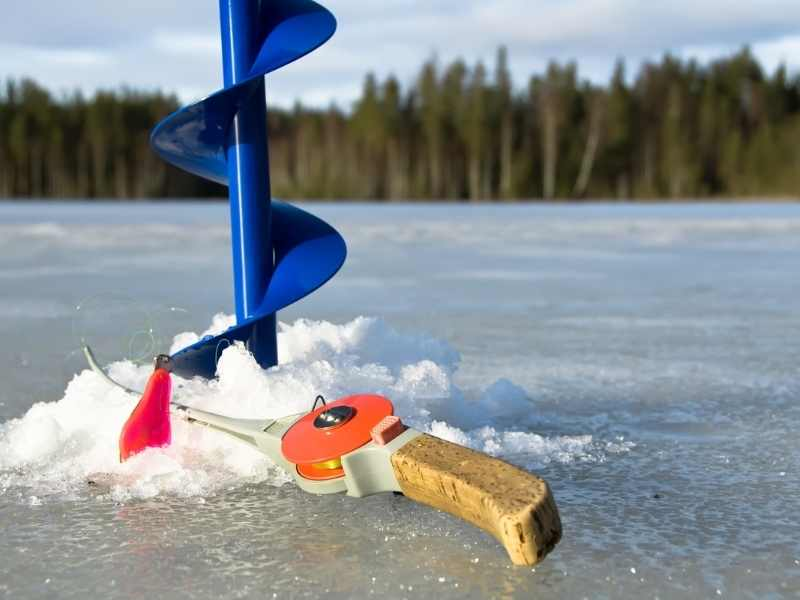 drilling hole in ice for catching perch